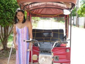"This is Charley and the ""motocab"" she and her husband run"